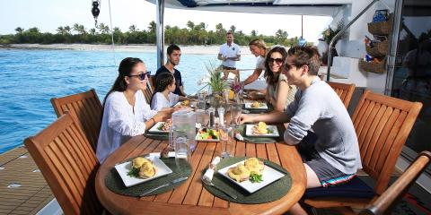 Family dining on Moorings 5800