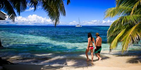 Couple walking on beach in Belize