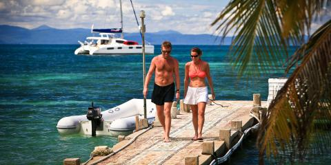 Couple walking on dock in Belize
