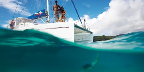 Swimming from catamaran in Tahiti