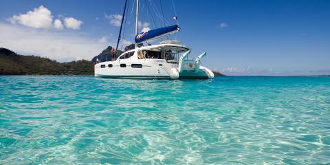 sailing catamaran with dinghy lift