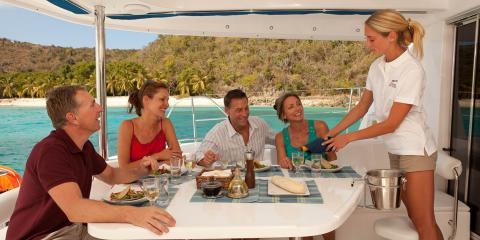 Family enjoying meal on yacht