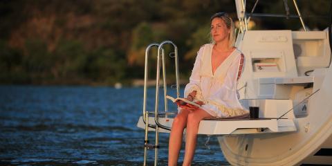Woman sitting on hydraulic dinghy