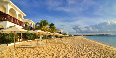 beach umbrellas on empty beach in St. Martin