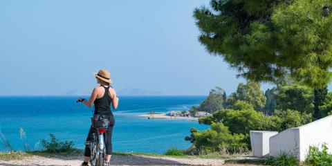 Woman cycling on Corfu Island, Greece