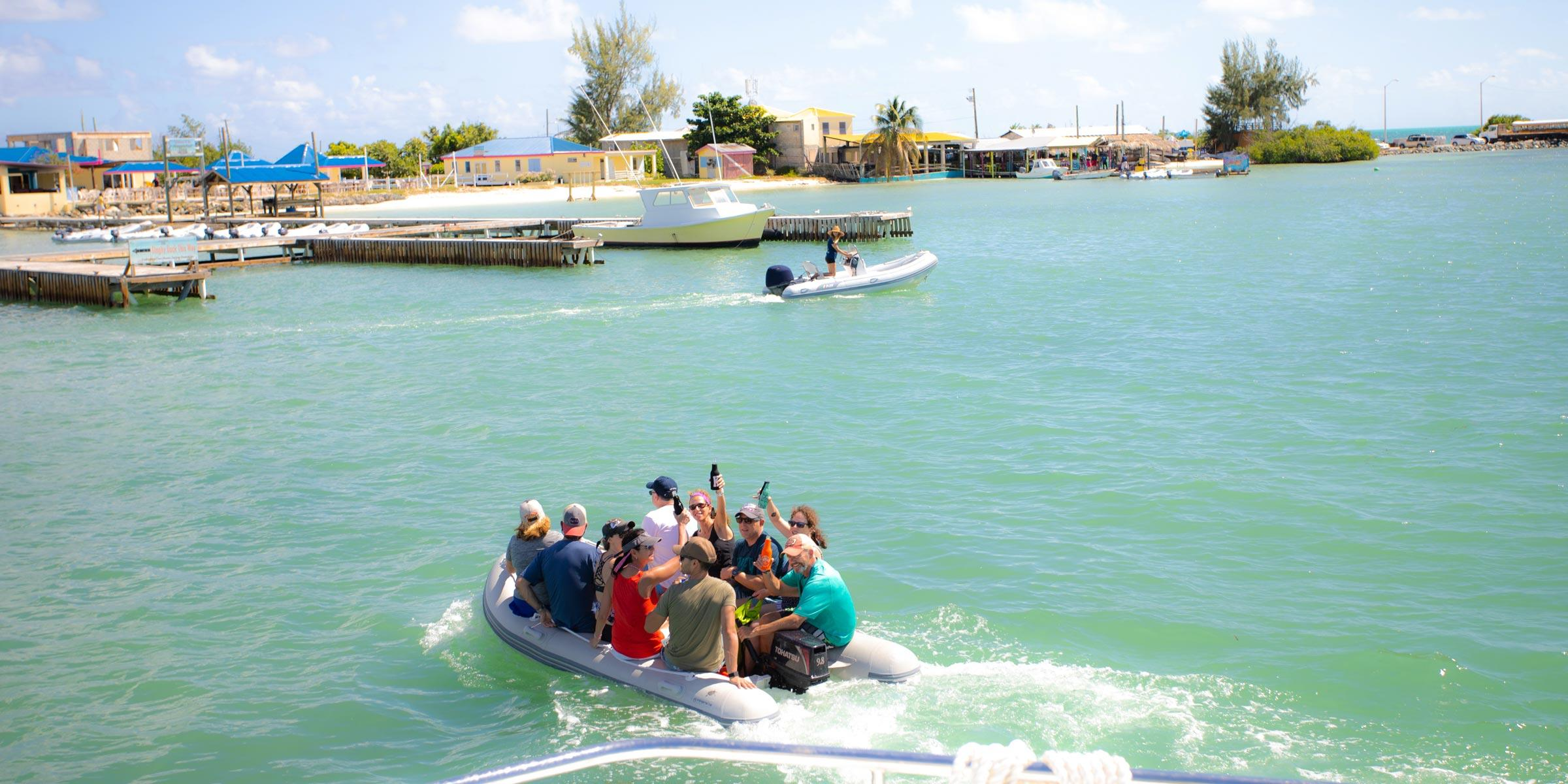 Charter guests taking the dinghy over to the island of Anegada