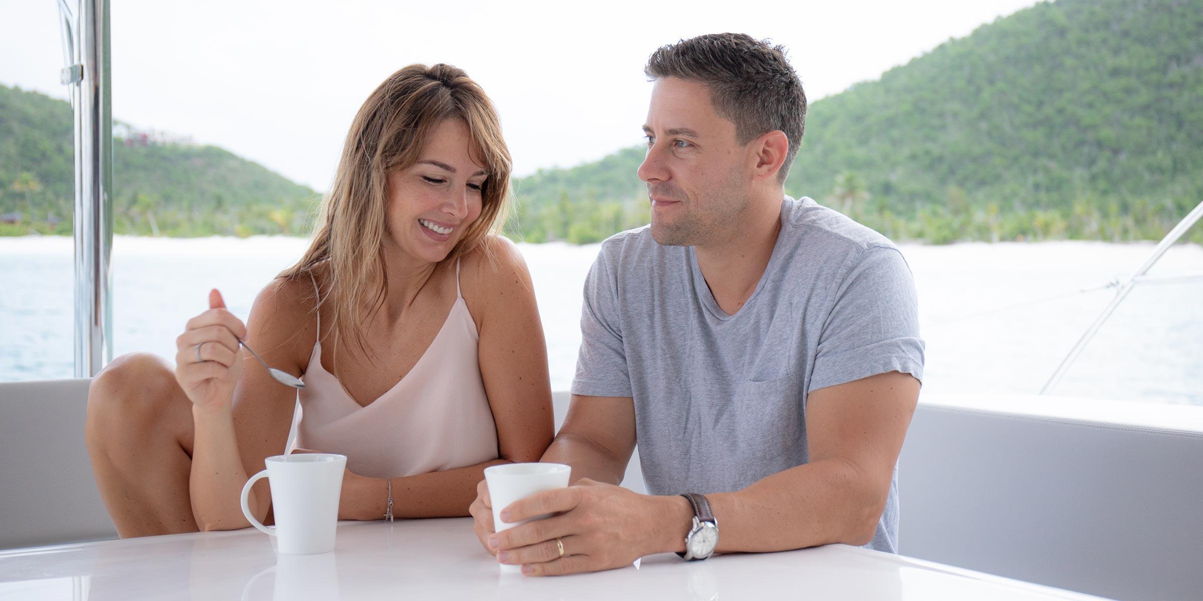 Couple enjoying their morning coffee in ceramic cups