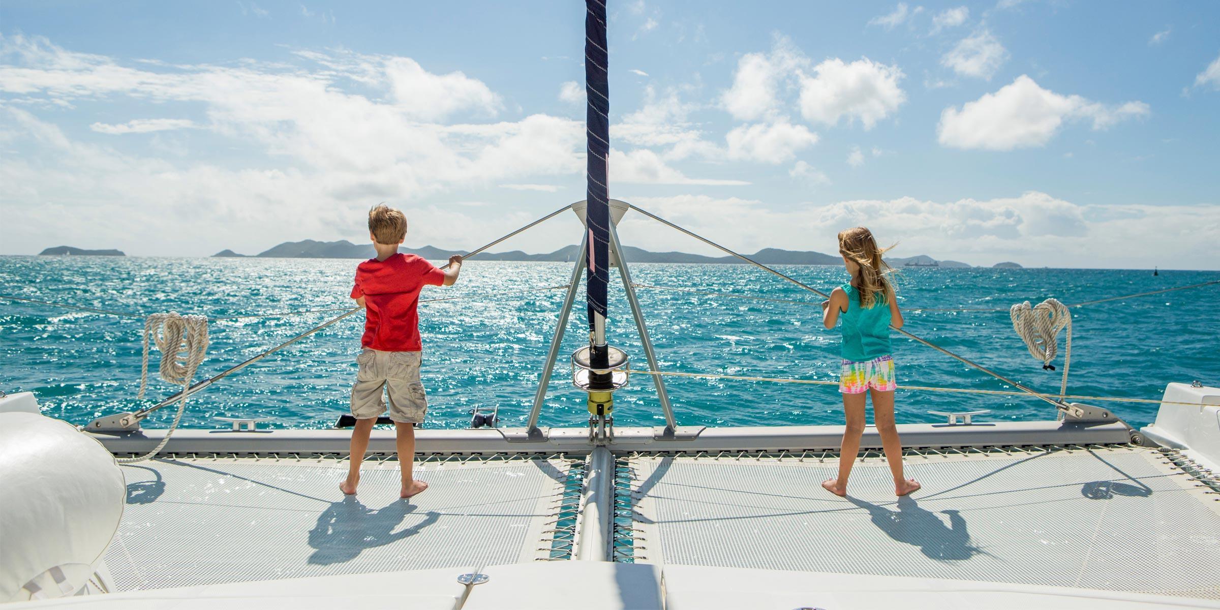 Children on catamaran trampoline in the BVI