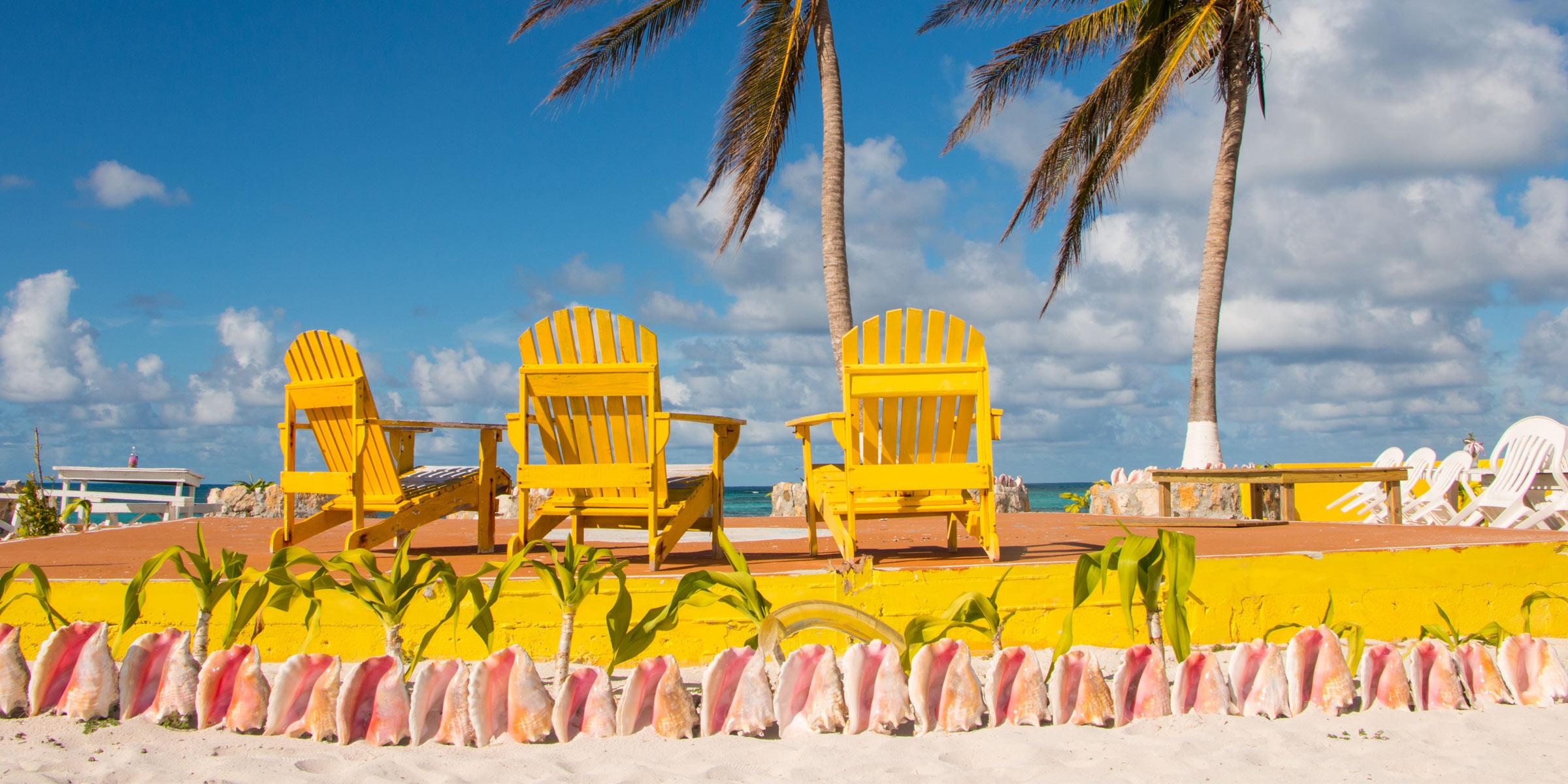 Colorful beach chairs at Cow Wreck Beach on Anegada, BVI