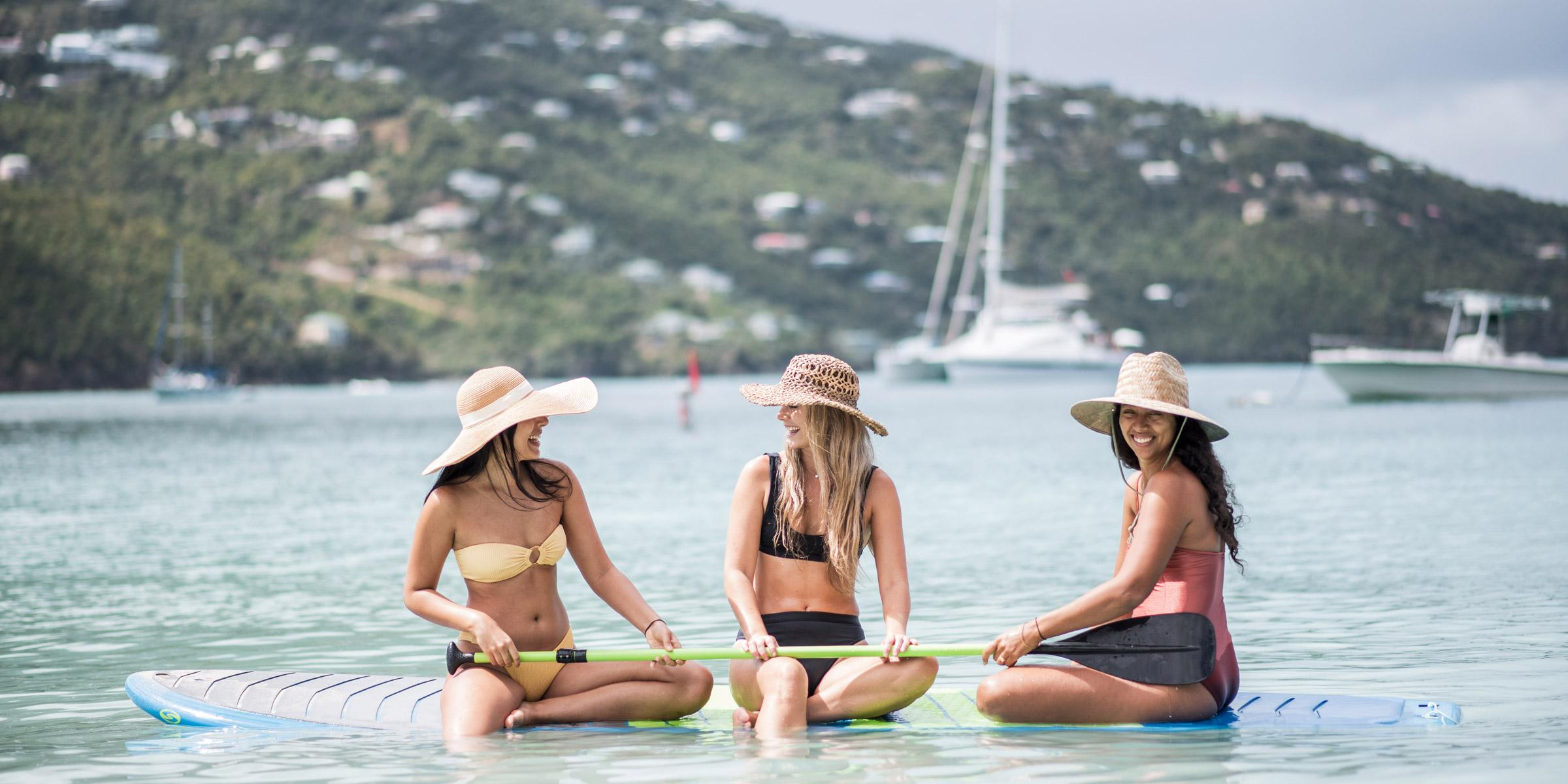 Women with paddleboard at Magen's Bay on St. Thomas, U.S. Virgin Islands