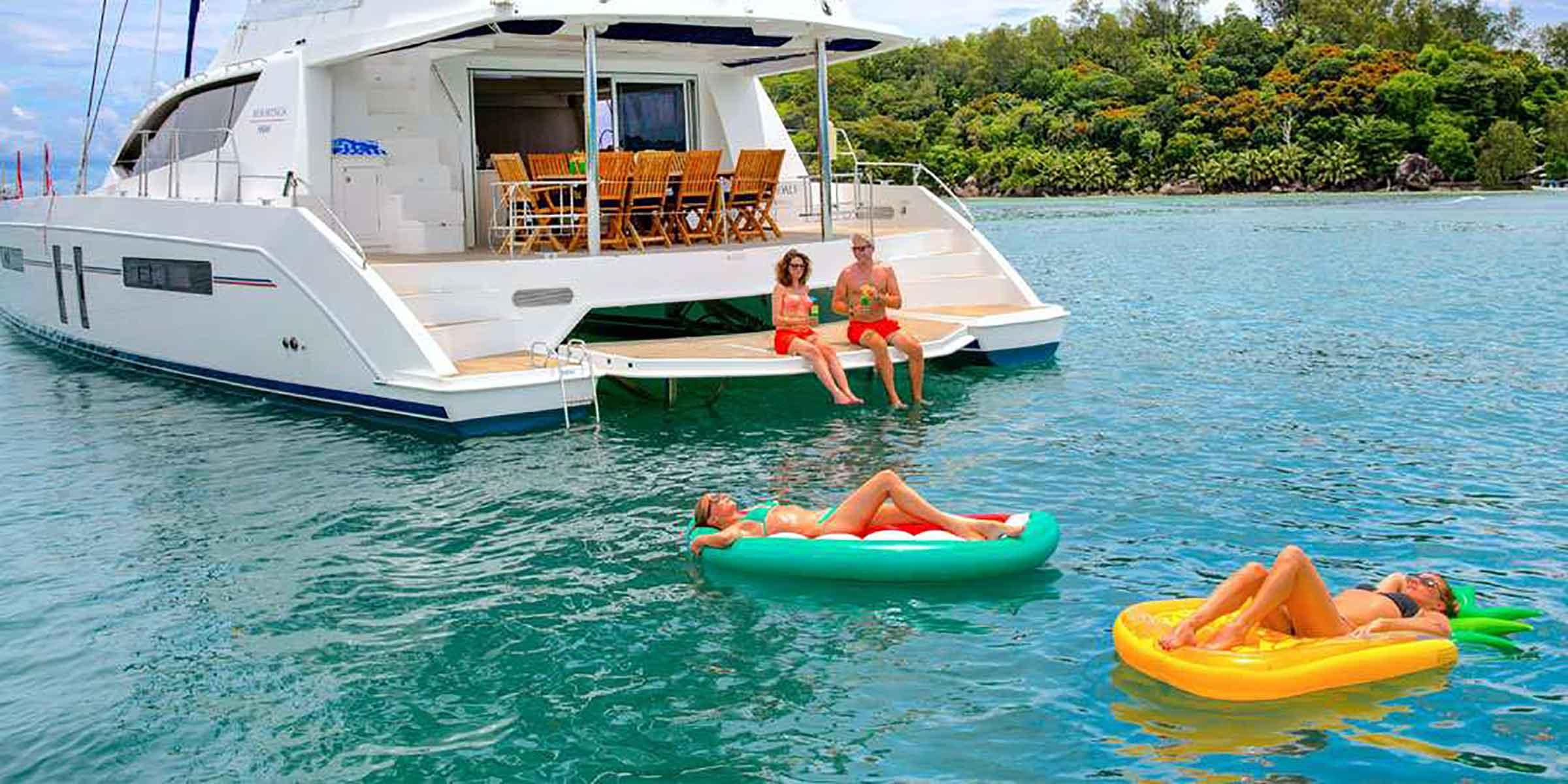 People relaxing on inflatable rafts in Caribbean